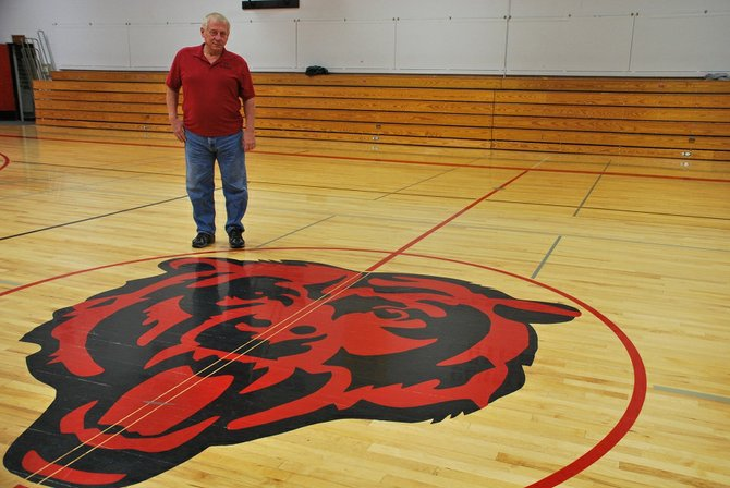 Roger Mortensen, of Klickitat, looks down on the Bruin in the middle of Columbia High School's gymnasium. Mortensen's company, D-S Hardwood Corporation, has refinished the hardwood floor at CHS among a long list of other schools in the area on down to Oregon and Arizona. Mortensen made the change by purchasing the business 14 years ago after being a coach, principal, and finally superintendent in the Klickitat School District.
