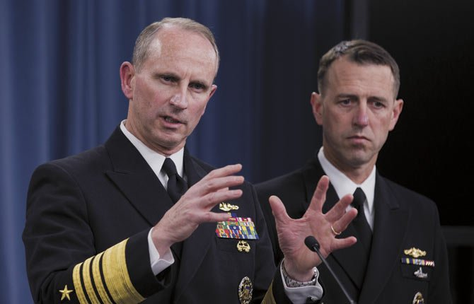 Chief of Naval Operations Adm. Jonathan W. Greenert, left, accompanied by Adm. John M. Richardson, director of the Naval Nuclear Propulsion Program, speaks during a news conference at the Pentagon, Tuesday, Feb. 4, 2014.  The Navy is investigating alleged cheating on tests by senior enlisted sailors training on naval nuclear reactors at Charleston, S.C., officials said Tuesday.