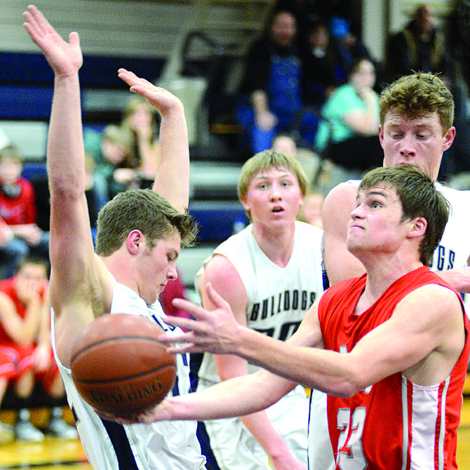 Alex Koberstein takes a charge from Clearwater Valley's Dillon Fisher during a 61-32 GHS win Feb. 10.