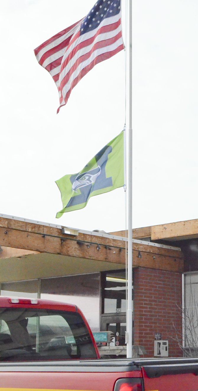 Personnel at the Sunnyside Fire Department are proudly displaying their favorite colors. A Seahawk flag can be seen waving in the wind along with Old Glory this week in celebration of the Seattle team's 'Super' victory over the Denver Broncos.