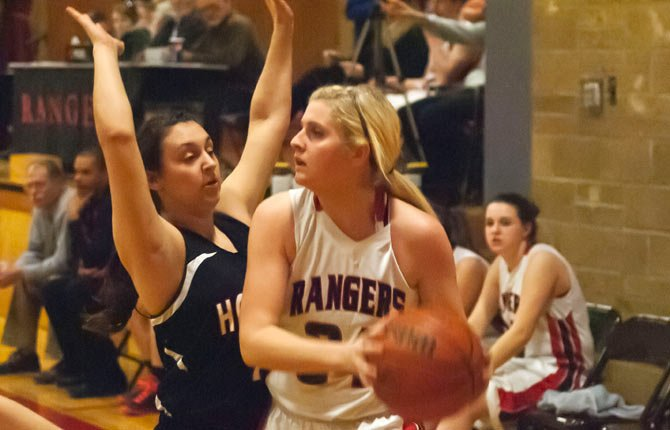 Dufur senior Sammi Ghramm, right, looks for an open player as the Rangers dominate Horizon Christian Wednesday in Dufur. Ghramm scored 10 points and the No. 7-ranked Lady Rangers broke open a 29-14 halftime advantage with a 20-14 run in the second half to defeat Horizon Christian, 49-28.