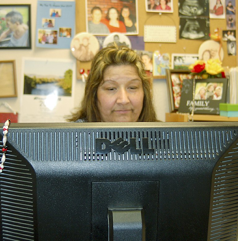 Carmelita Alvarez does a variety of tasks at Heartlinks Hospice and Palliative Care, including clinical support, scheduling nurses, admissions and equipment ordering.