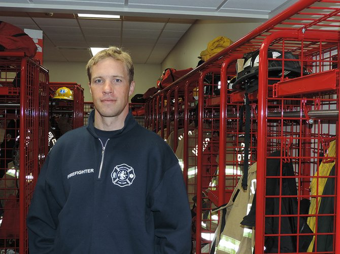 Dave Martin stands in the equipment room of the Hood River Fire Department's Ty Taylor Station.