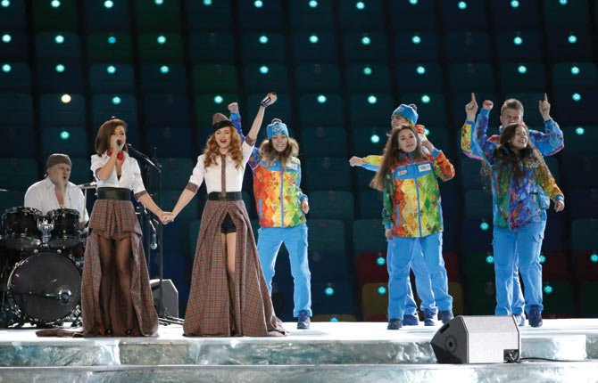 Russian duo t.A.T.u. Lena Katina, third from left, and Yulia Volkova, second from left,  perform on stage before the opening ceremony of the 2014 Winter Olympics in Sochi, Russia, Feb. 7.