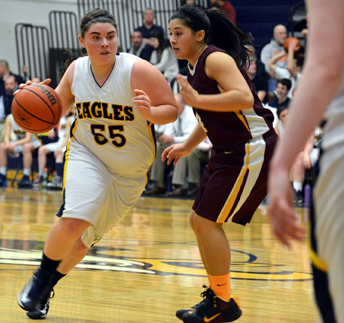 Annie veatch drives to the hoop in Tuesday's home game vs. The Dalles.