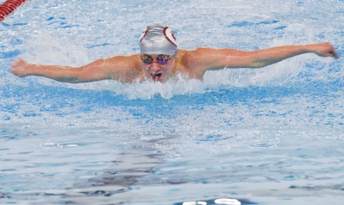 David Wascenske of Grandview churns through the water in the 100-yard butterfly event last Saturday at the District 5/6/7 meet in Ellensburg. Wascenske clocked a time of 1:05.11.