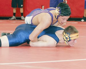 Emiliano Rodriguez of Mabton takes control of the 126-lb. opening round match against Jake Birch of Naches before pinning the Ranger in 1:45.
