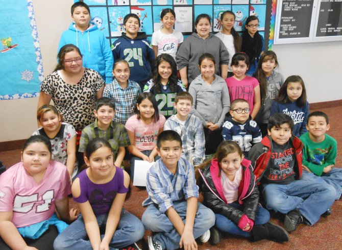 Sunnyside's Washington Elementary School third through fifth grade students for the month for January are (front row L-R) Sugar Lily Alviso-Rodriguez, Evelyn Sanchez, Jacob Montoya, Juliana Mancinas, Marc Aguila-Tellez and Christian Jacobo; (second row L-R) Lillian Campos, Carlos Ramos, Brianna Sanchez, Leif Van Doren, Eric Garcia and Amaliya Alvarado; (third row L-R) Kassandra Ruiz, Vanessa Moran-Tapia, Annesa Garcia, Priscilla Pacheco,  Areli Perez and Alexis Alaniz; (back row L-R) Kobe Sanchez, Nathan Martinez, Julie Rios, Monique Pena, Yarisi Gomez-Hernandez and Evelyn Arranda. Not pictured: Pablo Chavez, Yuridia Lupercio and Odelia Hernandez.