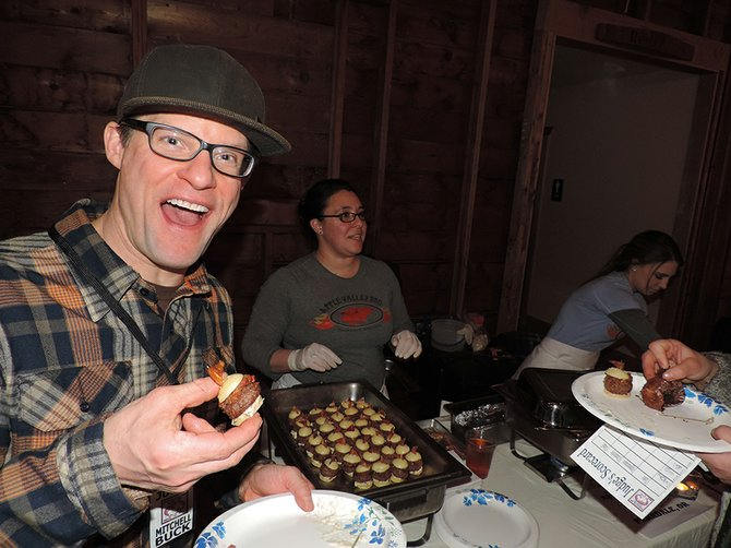 BACON-LOVING judge Mitchell Buck enjoys Leila Coe's winning bacon and beef sliders from Apple Valley.
