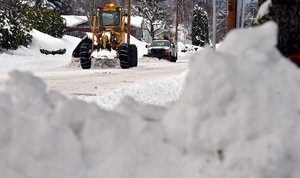 CITY crews remove snow on May Street.