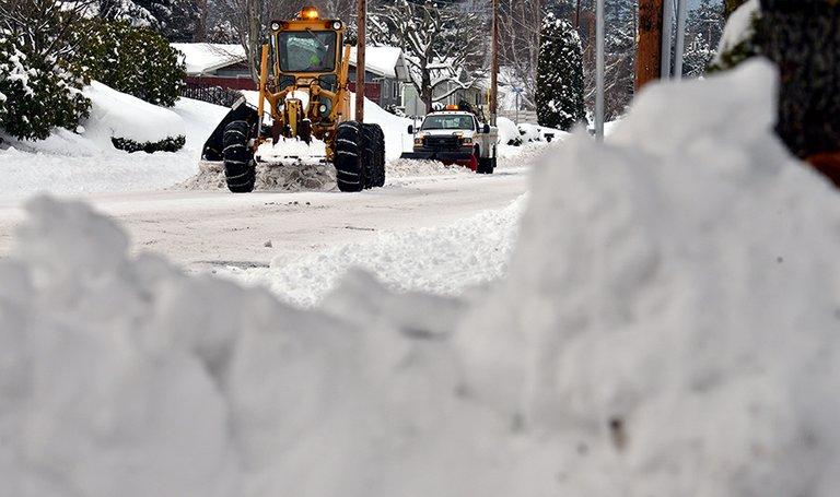 CITY crews remove snow on May Street.