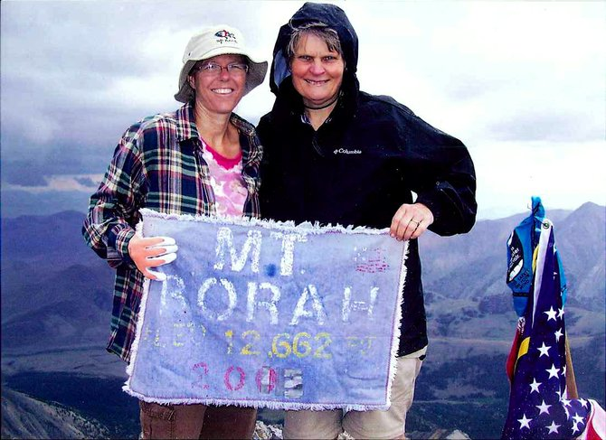 (L-R) Tami Plank and Sandra Reilly at the top of Mt. Borah on July 27, 2013.