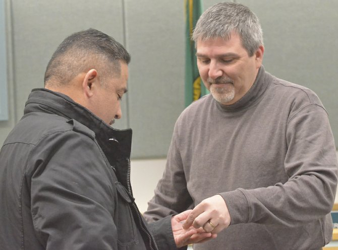 Mayor Jim Restucci, at Monday's Sunnyside City Council meeting, awarded pins to the sitting members of the Sunnyside Civil Service Commission, including chairman Jorge Castillo (pictured at left).