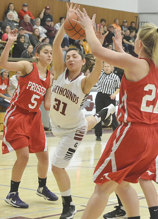 Grandview's Marissa Caballero (31) lunges for a loose ball, surrounded by several Prosser players during last night's regular season finale. Caballero scored 25 points to lead Grandview Tuesday night.