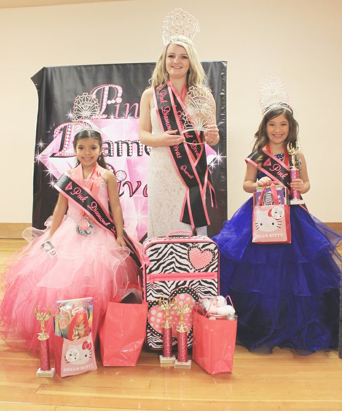 Audrina Campos, Jenny Hall and Brianna Garza (L-R) of Sunnyside show off their winnings at last Saturday's Pink Diamond Divas Pageant in Kennewick. Each of the young ladies were crowned queen in their respective age groups (5 to 6-year olds, 16 to 18-year olds and 7 to 9-year olds). Campos earned best Valentine wear, personality, photogenic, smile, hair and eyes honors. Hall earned honors for best personality, photogenic, hair, smile, eyes and Valentine wear. Garza won best hair, eyes, photogenic and Valentine wear honors.