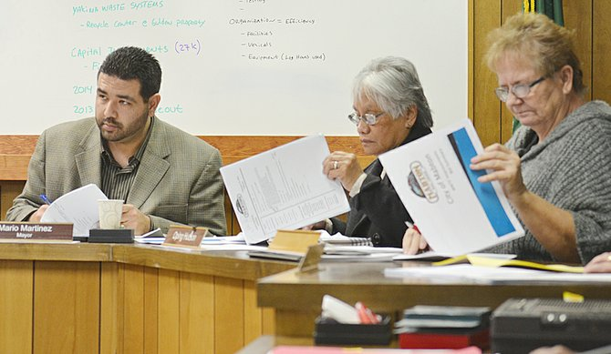 The Mabton City Council reviews documents before awarding a contract for construction of a new wastewater plant. Pictured from left are Mayor Mario Martinez, Councilwoman Oping Hutson and Councilwoman Vera Zavala.