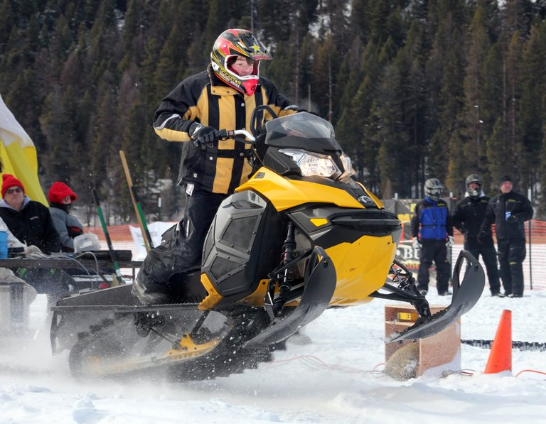 A racer launches off the startline Saturday and onto a 500-foot course during the annual Bonaparte Lake Snow Drags on the frozen waters of Bonaparte Lake.