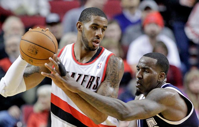 Oklahoma City Thunder center Kendrick Perkins, right, reaches in on Portland Trail Blazers forward LaMarcus Aldridge Tuesday in Portland.