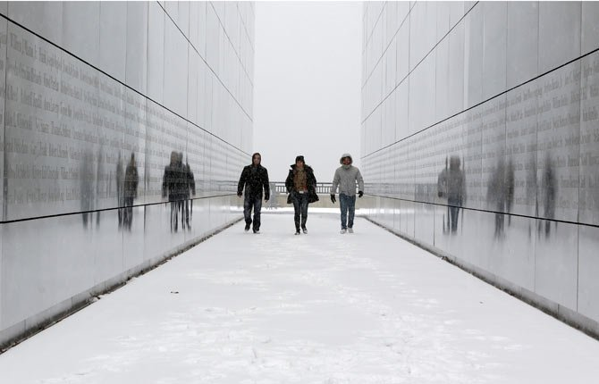 Tourists walk through the snow-covered Empty Sky Memorial at Liberty State Park in Jersey City, N.J. Researchers who analyzed local climate trends and hospital records on millions of Americans say there may be a link between weather and the risk for stroke. Cold weather, high humidity and big daily temperature swings brought more stroke hospitalizations. The study by researchers from Yale, Harvard and Duke universities was discussed today at a stroke conference in San Diego.