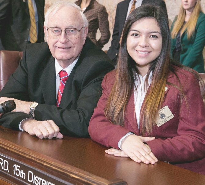 Toppenish High School sophomore Liliana Gutierrez worked as a student page for Sen. Jim Honeyford of Sunnyside last week in the Washington state legislature. Gutierrez was one of 18 teens who took part in the program during the third week of the 2014 legislative session. Pages deliver mail, run errands, present the flag and learn parliamentary procedure firsthand. Students also try their hand at drafting a bill and engage in a mock session.