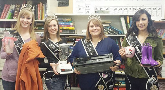 The Miss Sunnyside court will be holding a yard sale this coming Saturday, Feb. 15, to raise money for its expenses with the parade season. Pictured from left are Princesses Leah Diddens and Ashley Davis, Miss Sunnyside Alyson Spidle, and Princess Tiana Perez. The yard sale will be held at the Masonic temple, the corner of Harrison Avenue and Sixth Street, from 7 a.m. to 1 p.m. Items available for sale will include housewares and clothing.
