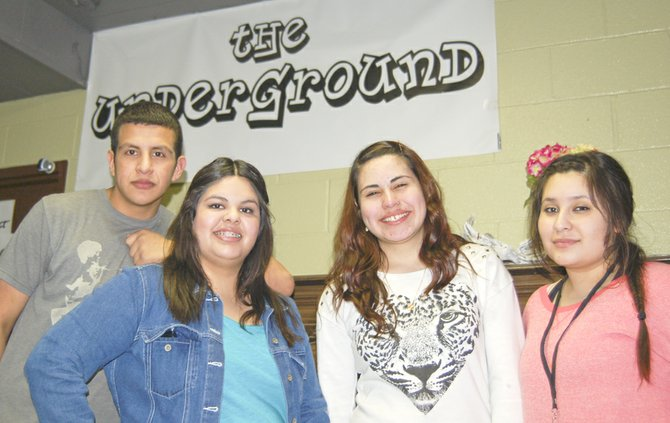 Jorge Villalobos, Maria Alvarez, Jocelyn Anguiano and Carina Gonzales (L-R) are students from a youth task force at Sunnyside High School that is volunteering at The Underground. The students staged a contest for a mural to be painted on a wall in the basement.