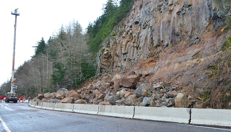 ROCKS and debris lie in the right eastbound lane of I-84 at milepost 61 Thursday morning. A landslide likely triggered by the weather occurred Wednesday evening, sending an estimated 2,000 cubic yards of debris into a portion of the freeway just a mile west of Hood River. Luckily, no one was injured, but the right eastbound lanes of I-84 remain closed from milepost 17 to 61.5.