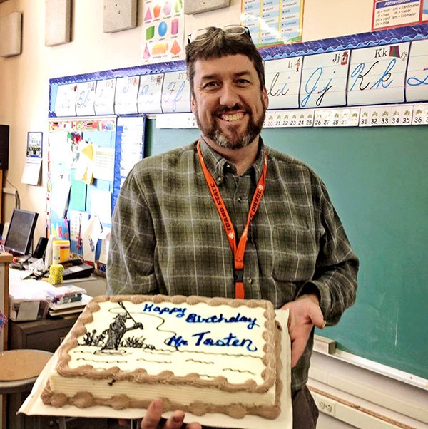 Joe Tosten, a teacher at Clearwater Valley Elementary School in Kooskia, was treated with an ice-cream cake from his wife, Michelle Tosten, a speech-language pathologist with Mountain View School District 244, at school two weeks ago.
