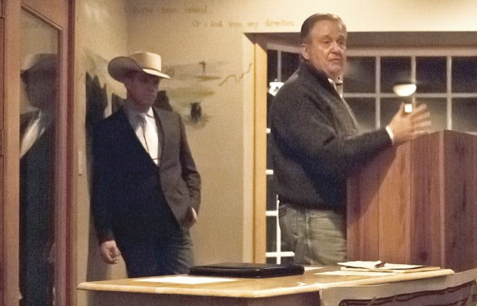 OREGON CATTLEMEN Association's president Ray Sessler speaks at the North Central Livestock Association meeting in Maupin Feb. 15. The state association is growing, Sessler noted, and cattlemen are benefiting from improved representation in Salem. In the background is Keith Nantz, head of the organization made up of ranchers from Sherman and Wasco counties.