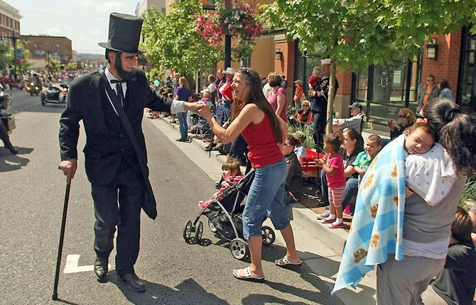 Robert Brown plays the part of Abraham Lincoln, as he greets those along the 2012 Armed Forces Day Parade route. Brown, who portrayed Lincoln at patriotic events, died Feb. 12, the 16th president's birthday.