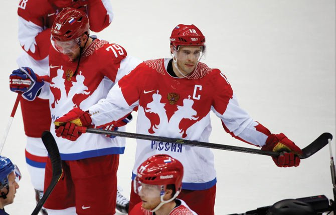 Russia defenseman Andrei Markov, left, and forward Pavel Datsyuk react after Russia lost 3-1 to Finland in a men's quarterfinal ice hockey game in Sochi, Russia.