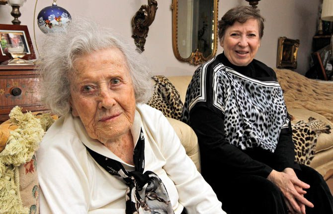 Harriet Butler, now 102, left, and her daughter Marcia Savarese, are photographed at Savarese's home in Vienna, Va. Safety researchers expressed concern a decade ago that traffic accidents would increase as the nation's aging population swelled the number of older drivers on the road. Now, they say they've been proved wrong.