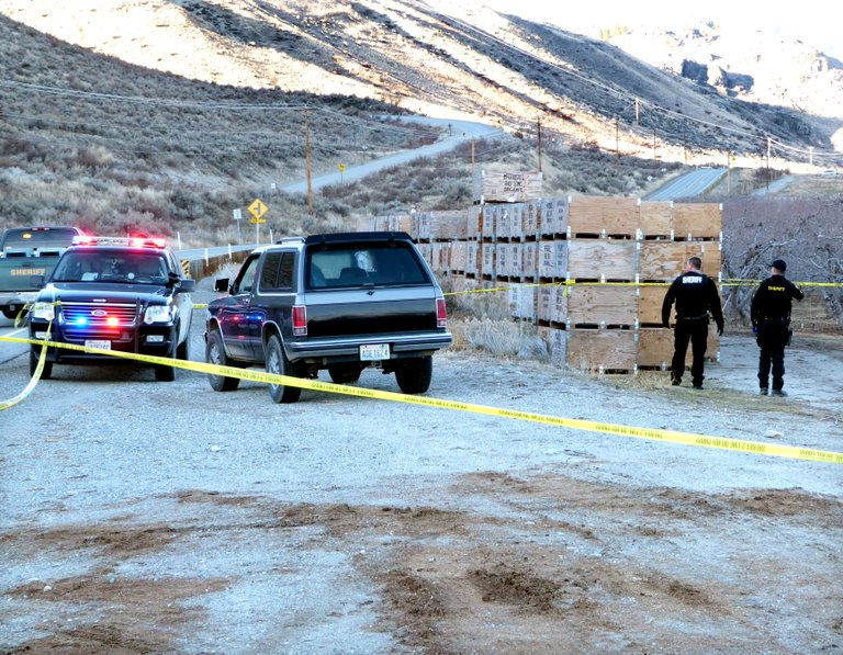 Okanogan County Sheriff's Office deputies investigate the scene of a fatal shooting Thursday along Old Highway 97, just south of Chiliwist Road.