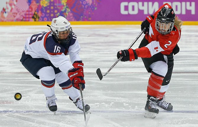 Meghan Agosta-Marciano of Canada (2) shoots against Kelli Stack of the United States (16) during the women's gold medal ice hockey game at the 2014 Winter Olympicstoday in Sochi, Russia. Look for outcome online at www.thedalleschron