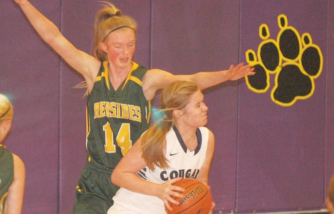 SWC senior Zoe Morelli plays defense in the post Thursday in Hermiston. The Redsides lost to Echo in their district opener, 39-15.