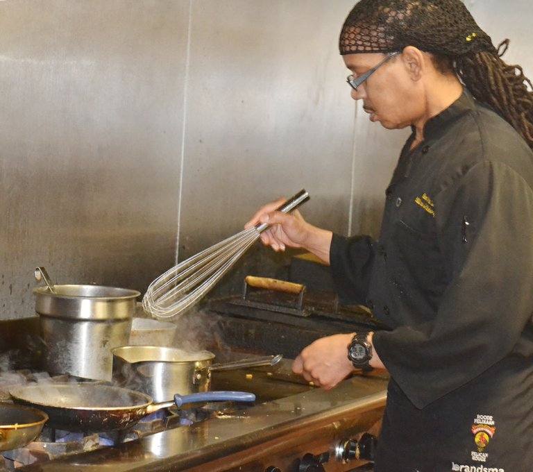 Bon Vino's Chef Kenny Harding whips up a cream sauce in the Sunnyside restaurant's kitchen.