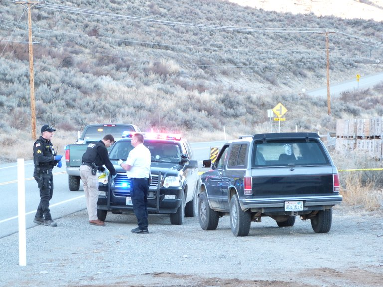 Investigators arrive on scene yesterday south of Malott after a migrant worker was shot and killed.