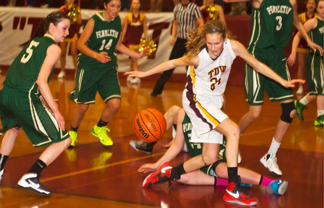 The Dalles Wahtonka junior Katie Conklin (front) responds to a loose ball as Pendleton turns over possession late in Friday's 5A basketball game at Kurtz Gym in The Dalles. The Lady Bucks built a double-digit lead and held on for a 60-57 overtime win.