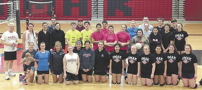 Volunteers and players pose for a group photo following play in the Parker's Place volleyball tournament Saturday at Omak High School.