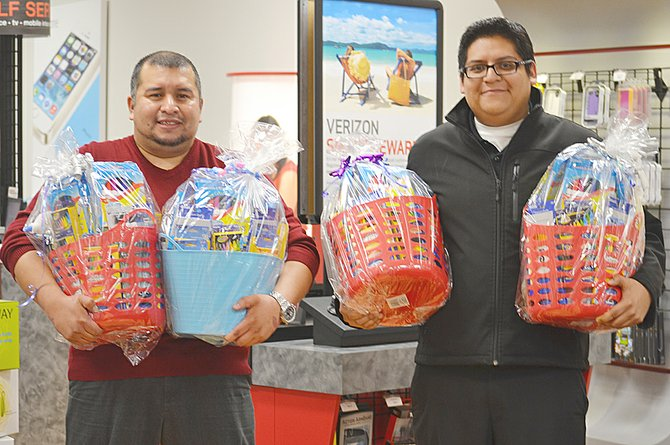 Ten local teachers were the lucky recipients last Sunday night of free school supply packs distributed by The Cellular Connection in Sunnyside. Pictured are store manager Miguel Saldana Jr. (L) and sales associate Felipe Cruz with some of the supply baskets that included pencils, glue, pens, markers, erasers, paper, tissue boxes and more. Nationwide, the Verizon wireless retailer distributed supply packs to 3,500 teachers as part of the company's Teachers Rock Supply Giveaway. The local store will also participate in a giveaway later this year that will see The Cellular Connection distribute 100,000 school supply backpacks to students nationwide. The Sunnyside store hopes to have about 200 of those backpacks to distribute to local students.