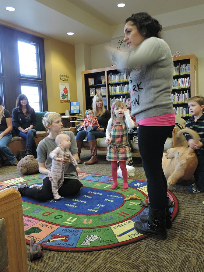 LIBRARY PROGRAMS, such as Story Hour, get a boost from Feast of Words.