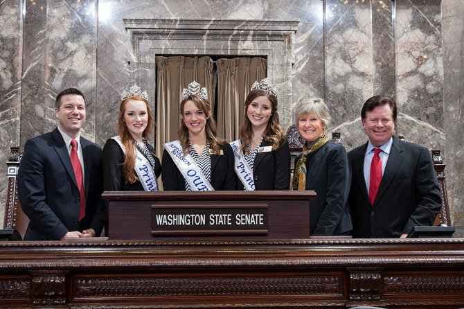 Rep. Brad Hawkins, from left, Princess Nikara Morgan, Queen Roslyn Thompson, Princess Caroline Dahl, Sen. Linda Evans Parlette and Rep. Cary Condotta pose for a photo in the Senate chamber Feb. 24.