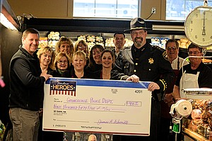 Hometown Heroes Cash and Carry recently handed over funds to the Grangeville Police Department raised from its Hometown Heroes promotion.