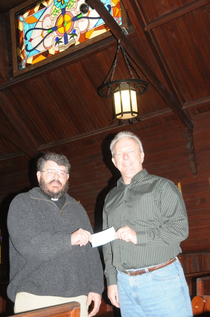 Trinity Episcopal Church in Grangeville hands a check for $5,000 to John Bennett who represents the  Grangeville Community Foundation (GCF) Endowment Fund.