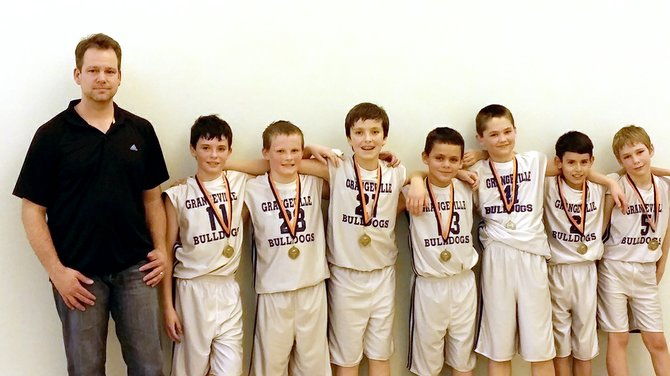 Grangeville's fourth and fifth grade boys team, coached by Nolan Schoo, won the Kendrick Tournament last Saturday, Feb. 22, with a 4-0 record.  Pictured are (from left):  Jared Lindsley, Caleb Frei, Blake Schoo, Tori Ebert, Jaret McFrederick, Emilio Barela, and Isaac VanDomelen.