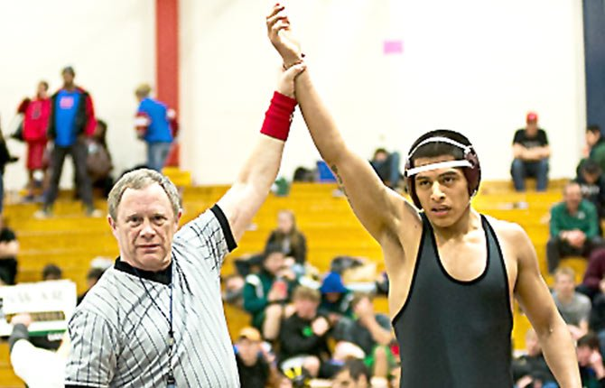 THE DALLES WAHTONKA wrestler Eric Morales gets his arm raised the Feb. 22 Special District 2 tournament in Portland.