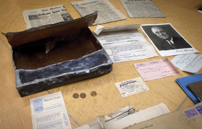 TIME CAPSULE contents, buried beneath a cornerstone of the Lewis and Clark monument pedestal, were unearthed this month when the monument was removed to make way for future development of a swimming pool and offices at Thompson Park in downtown The Dalles. The items date back to 1941.