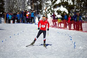 SAM WILEY smiles as he approaches the finish line of the 2014 OHSNO state 7.5K skate race Saturday in Bend.