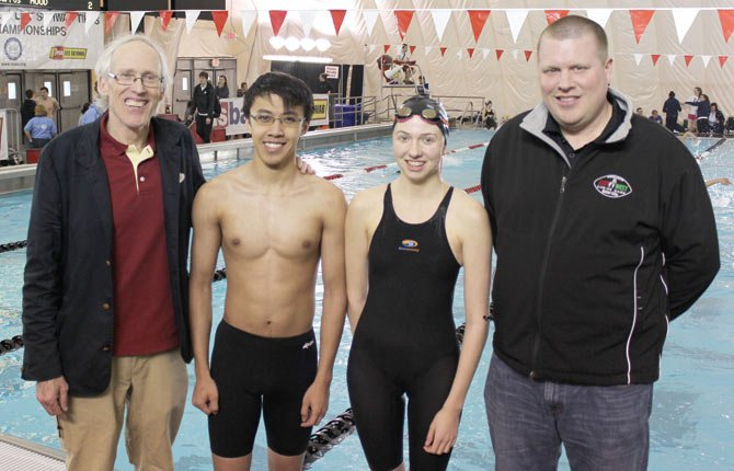 while at the OSAA state swimming championships in Gresham Saturday, The Dalles Wahtonka coach Scott McKay (far left) and athletic director Mike Somnis (right) stand next to state qualifiers, Ming Ou and Erin Nelson. Contributed photo