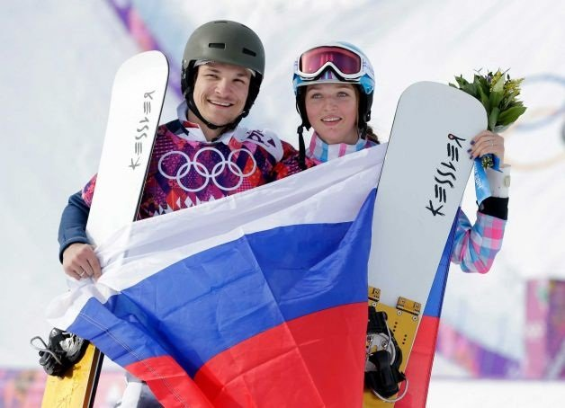Vic Wild and his wife, Alena Zavarzina, clutch the Russian flag moments after Wild won his first gold medal at the Sochi Winter Olympics on Feb. 19. Wild, originally of White Salmon, is the first American-born athlete to compete for Russia and took another gold medal in the Parallel Slalom on Feb. 22. Zarvarzina also took the bronze in women's Parallel Giant Slalom.